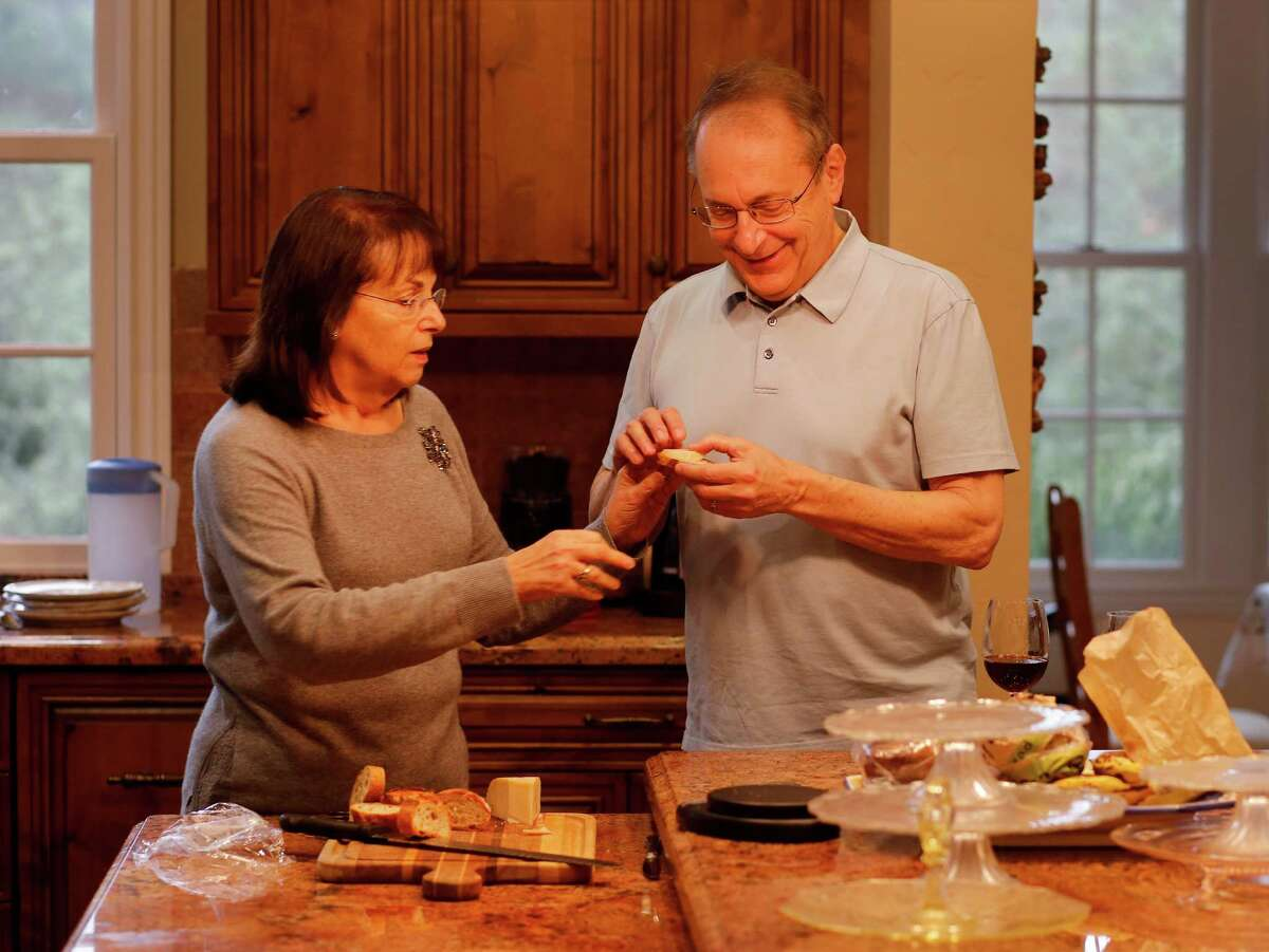 Paul Zygielbaum - who suffers from deadly, asbestos-caused mesothelioma - and his wife, Michelle, fix a snack at home in Santa Rosa. Sixty nations ban asbestos, but the industry's clout has stifled efforts to eradicate it in the United States.