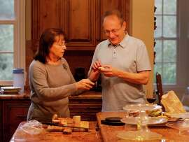 Paul Zygielbaum — who suffers from deadly, asbestos-caused mesothelioma — and his wife, Michelle, fix a snack at home in Santa Rosa. Sixty nations ban asbestos, but the industry's clout has stifled efforts to eradicate it in the United States.