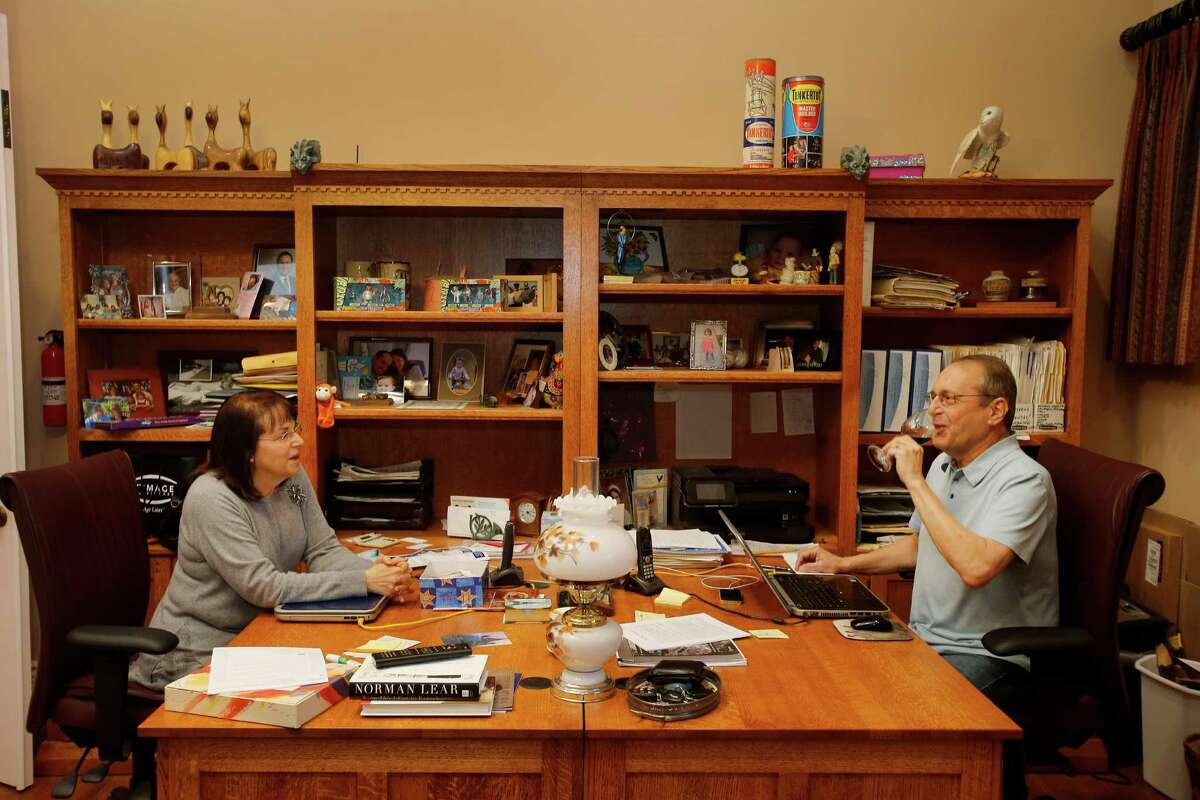 Paul and Michelle Zygielbaum share an office and a desk space where they can talk at their Santa Rosa, Calif. home Wednesday December 17, 2014. Paul Zygielbaum was diagnosed with mesothelioma because of asbestos exposure in 2003. He is determined to make the public aware of the asbestos in products even today.