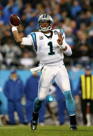 CHARLOTTE, NC - JANUARY 03:  Cam Newton #1 of the Carolina Panthers attempts a pass during their NFC Wild Card Playoff game against the Arizona Cardinals at Bank of America Stadium on January 3, 2015 in Charlotte, North Carolina.  (Photo by Streeter Lecka/Getty Images) ORG XMIT: 530751411 Photo: Streeter Lecka / 2015 Getty Images