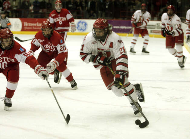 RPI's Mark McGowan carries the puck into the corner against Boston University during Saturday's game in Troy. (Ed Burke / Special to the Times Union)