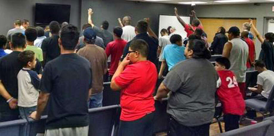 Some 80 men gather each Wednesday for Man Church, a program dedicated to building men and raising sons, at PowerHouse Church in Katy.  Photo courtesy PowerHouse Church. Photo: Photo Courtesy PowerHouse Church / Photo courtesy PowerHouse Church