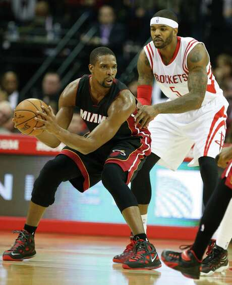 Veteran Heat center Chris Bosh says he turned down the Rockets because he wanted to be a part of Miami's rebuilding efforts. Photo: Karen Warren, Staff / © 2014 Houston Chronicle
