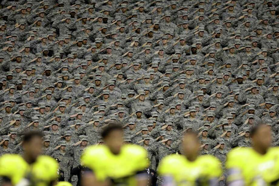 Members of the Army salute during the national anthem before the start of Saturday's U.S. Army All-American Bowl in San Antonio. Photo: Eric Gay, STF / AP