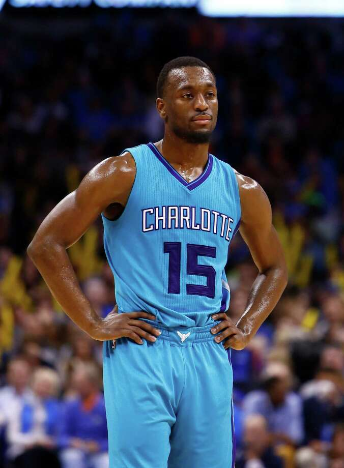 Charlotte Hornets guard Kemba Walker (15) waits for a time out to end during the second half of an NBA basketball game in Oklahoma City on Friday, Dec. 26, 2014. Oklahoma City won 98-75. (AP Photo/Alonzo Adams) Photo: Alonzo Adams, FRE / FR159426 AP