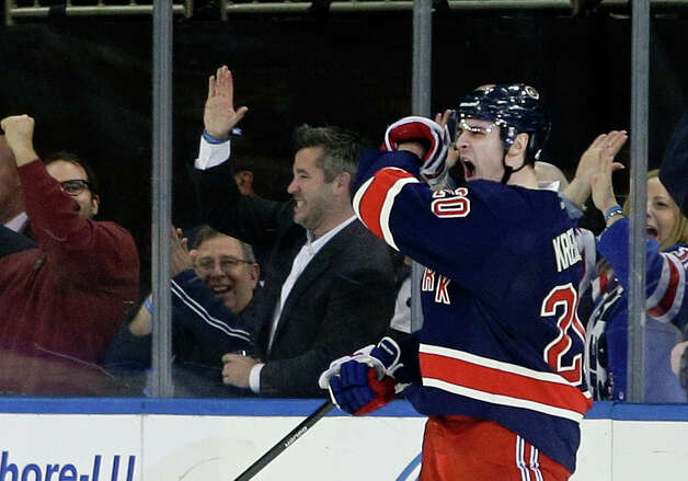 New York Rangers' Chris Kreider (20) celebrates after scoring a goal during the first period of an NHL hockey game against the Buffalo Sabres, Saturday, Jan. 3, 2015, in New York. (AP Photo/Frank Franklin II) ORG XMIT: MSG106 Photo: Frank Franklin II / AP