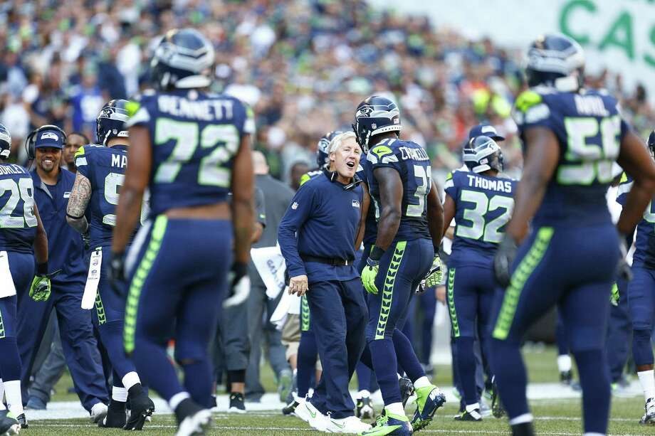 Seattle Seahawks head coach Pete Carroll celebrates with Seahawks safety Kam Chancellor after Chancellor prevented a pass completion to Broncos wide receiver Wes Welker on a third down during the third quarter on Sunday, Sept. 21, 2014, at CenturyLink Field in Seattle. (John Lok/Seattle Times/MCT) Photo: John Lok, MBR / Seattle Times