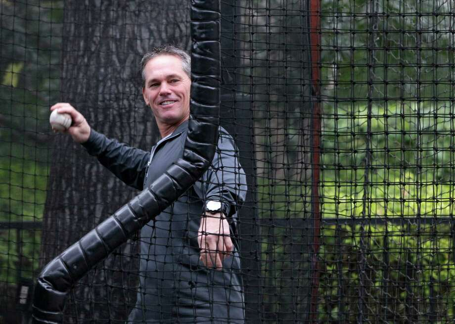 It's hard for Craig Biggio not to smile when he's in his element - throwing batting practice to his sons, Cavan and Conor, in the backyard of their West University home. Those days have become more precious for the 2015 Hall of Fame hopeful since the boys attend Notre Dame. Photo: Melissa Phillip, Staff / © 2014  Houston Chronicle