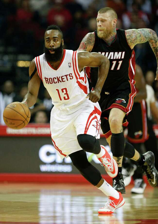 Houston Rockets guard James Harden (13) runs the ball up the court with Miami Heat forward Chris Andersen (11) during the first half of an NBA game at Toyota Center, Saturday, Jan. 3, 2015, in Houston. ( Karen Warren / Houston Chronicle  ) Photo: Karen Warren, Staff / © 2014 Houston Chronicle