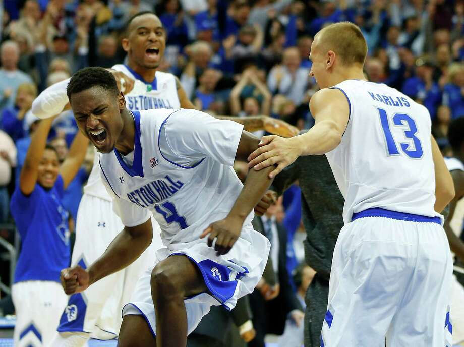 Seton Hall's Sterling Gibbs, front, celebrates with his teammates after the Pirates upset sixth-ranked Villanova 66-61 in overtime Saturday. Photo: Rich Schultz, Stringer / 2015 Getty Images