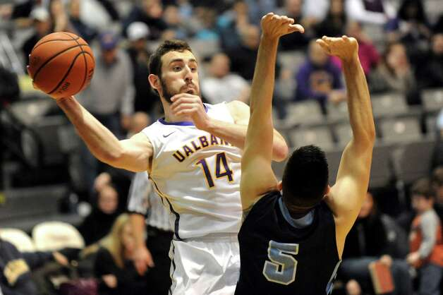 UAlbany's Sam Rowley, left, looks to pass as Maine's Zarko Valjarevic defends during their basketball game on Saturday, Jan. 3, 2015, at SEFCU Arena in Albany, N.Y. (Cindy Schultz / Times Union) Photo: Cindy Schultz / 00029991A