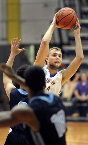 UAlbany's Dallas Ennema, right, looks to pass during their basketball game against Maine on Saturday, Jan. 3, 2015, at SEFCU Arena in Albany, N.Y. (Cindy Schultz / Times Union) Photo: Cindy Schultz / 00029991A