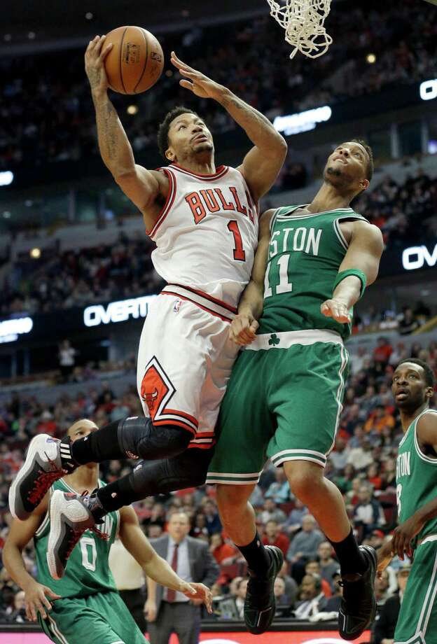 Chicago Bulls guard Derrick Rose (1) drives to the basket against Boston Celtics guard Evan Turner (11) during overtime of an NBA basketball game in Chicago on Saturday, Jan. 3, 2015. The Bulls won in overtime 109-104. (AP Photo/Nam Y. Huh) ORG XMIT: CXA112 Photo: Nam Y. Huh / AP