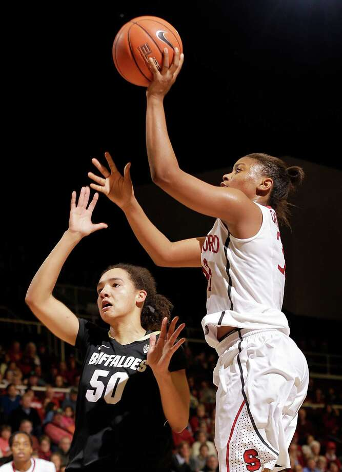 Stanford's Amber Orrange shoots over Colorado's Jamee Swan during Orrange's career-high 26-point performance in the Pac-12 opener at Maples Pavilion. Backcourt mate Lili Thompson added 17 but no other member of the Cardinal had more than seven. Photo: Jeff Chiu / Associated Press / AP