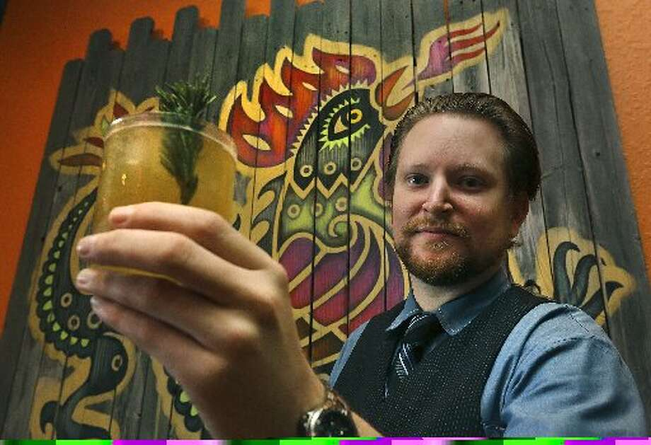 "Chef and owner Jason Dady kicked off the year by closing Umai Mi January 1. Pictured here is bartender Josh Finnie serving up a ""Lil'bit Country"" drink. Photo: Bob Owen / San Antonio Express-News"