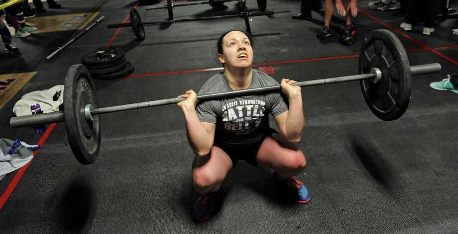 Alexis Perri, 21, of New Milford, does a thruster as part of the WOD (workout of the day) competition during the CrossFit RedZone third annual fundraiser to support the town, families, and community of Newtown, on Saturday, January 3, 2015, in Newtown, Conn. All proceeds from the event will be directed to The University of Connecticut Foundation, Inc. to benefit the Sandy Hook School Memorial Scholarship Fund. Photo: H John Voorhees III / The News-Times
