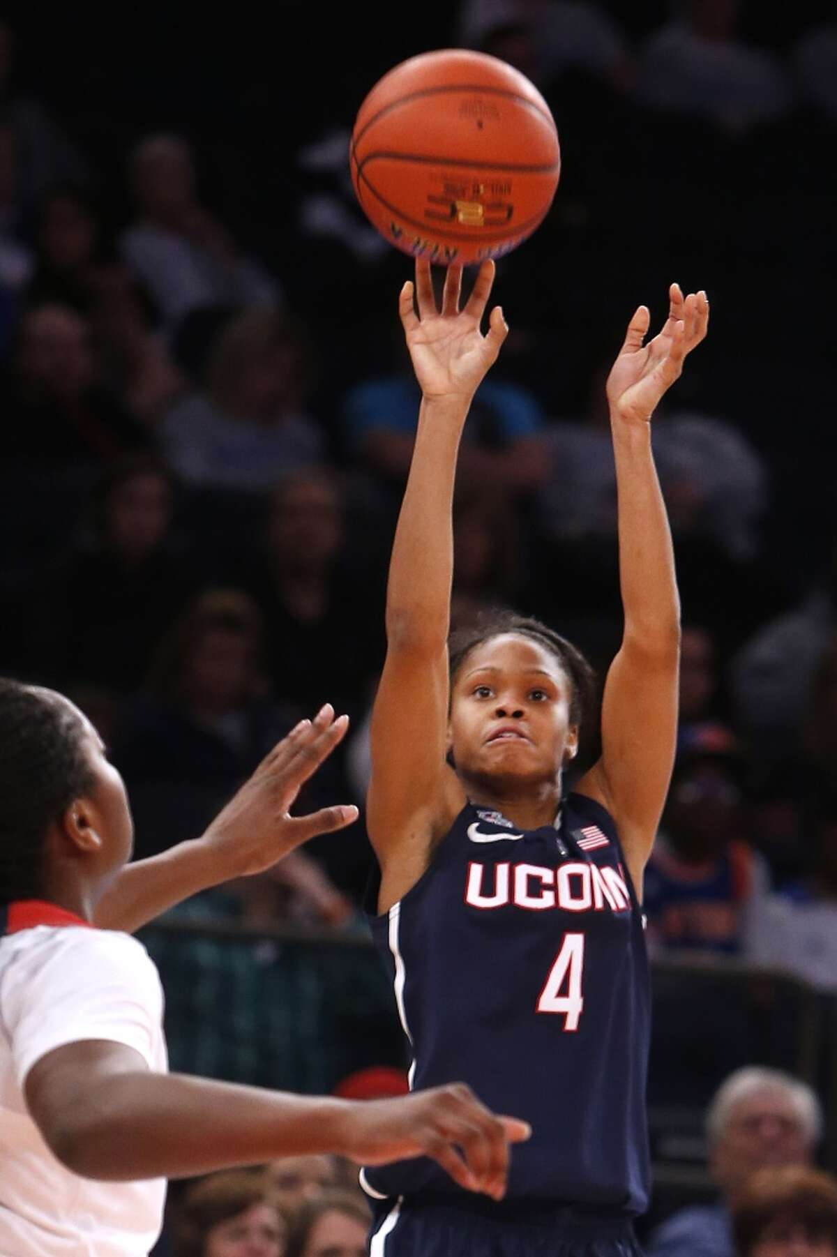 Connecticut's Moriah Jefferson (4) shoots against St. John's during the second half of an NCAA college basketball game, Sunday, Jan. 4, 2015, in New York. Connecticut defeated St. John's 70-54. (AP Photo/Jason DeCrow)
