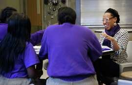 Program director at the Rosenberg Foundation Lateefah Simon works with a group of girls at San Francisco's Juvenile Hall on Friday Jan. 02, 2015 in San Francisco, Calif. Simon is being recognized as a visionary of the year by the San Francisco Chronicle.