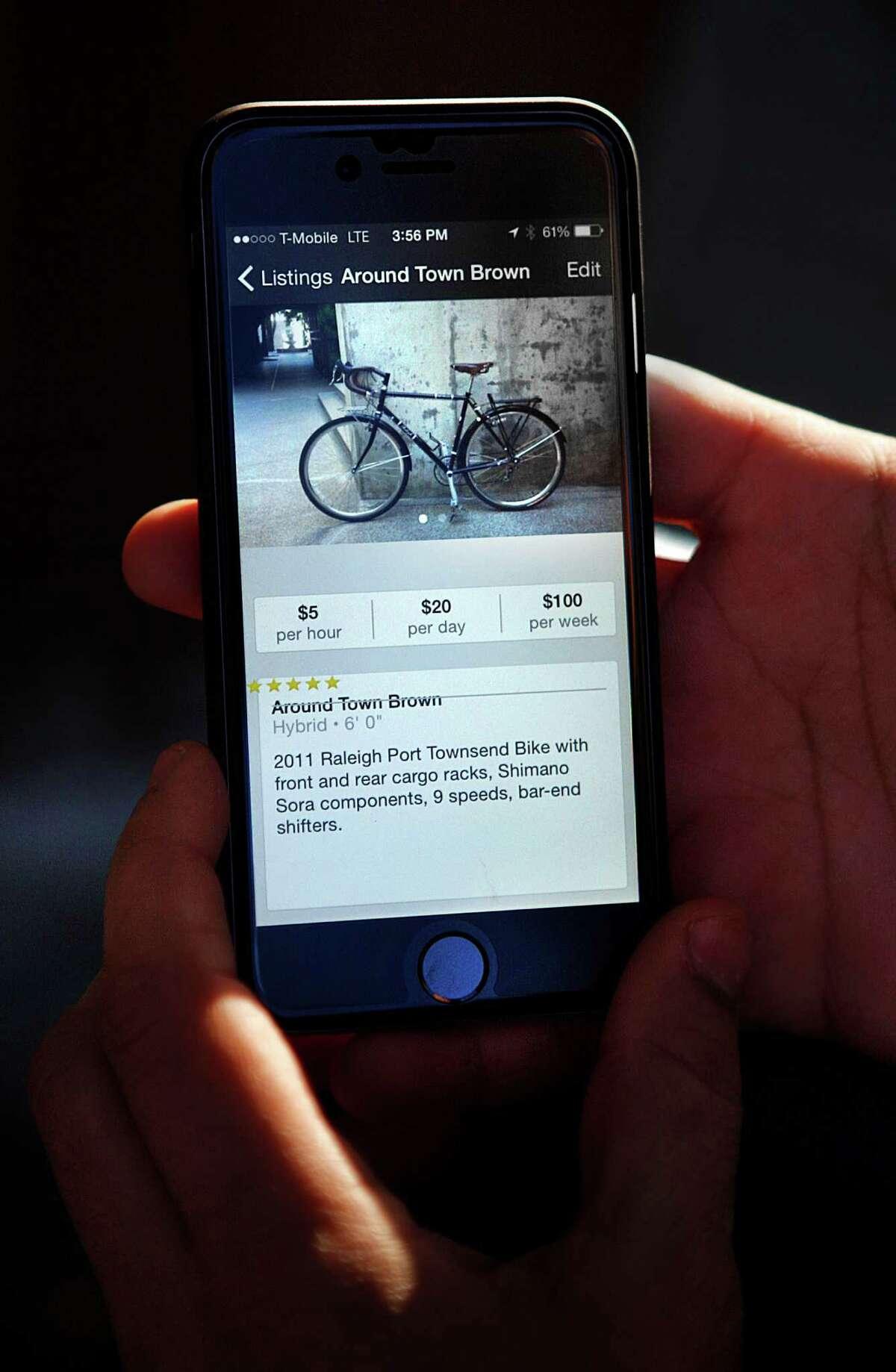 Nikhil Balaraman shows his bike on the Spinlister website in San Francisco, Calif., on Tuesday, December 30, 2014.