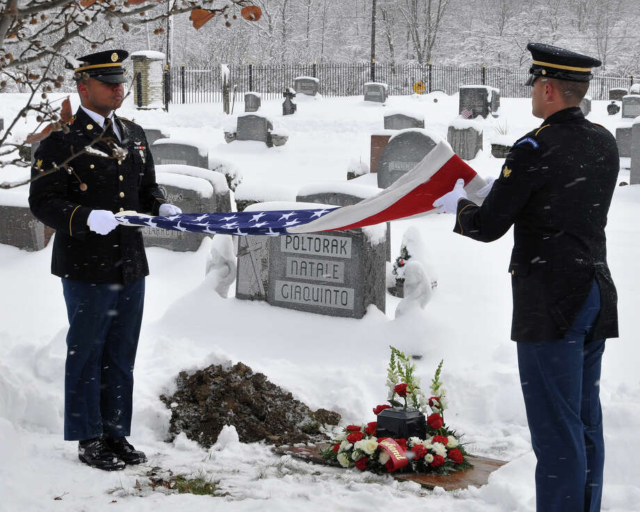 Photo by Master Sgt. Corine Lombardo / New York Army National Guard Specialists Anthony Bryant, left, and Shelbi Vanderbogart perform funeral honors for Army veteran Charles Smith in Amsterdam on Dec. 11.