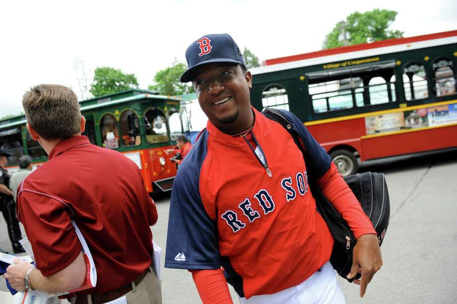 Pedro Martinez, center, arrives at Doubleday Field for the sixth annual Hall of Fame Classic baseball game on Saturday, May 24, 2014, in Cooperstown, N.Y. (Cindy Schultz / Times Union) Photo: Cindy Schultz / 00027031A