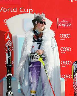 Mikaela Shiffrin dons the Snow Queen crown and cape awarded after her victory.