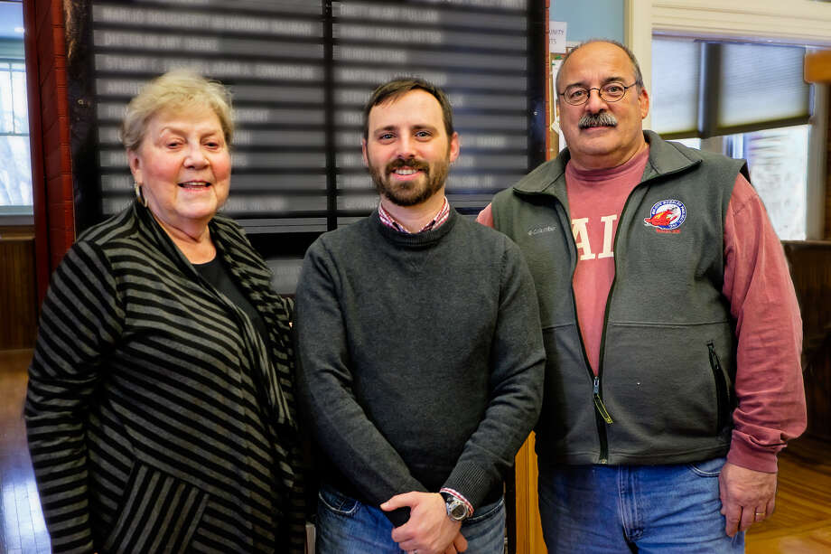 Altamont Free Library's new director Joseph Burke, center, stands with  board trustees Pat Spohr, left, and Tony Kossmann. (Photo by Ronald Ginsburgh, Altamont Free Library board trustee) / ©Ron Ginsburg