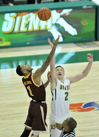 Isaiah Williams of Iona, left, and Willem Brandwijk of Siena battle for the jump ball at the start of their game at the Times Union Center on Sunday, Jan. 4, 2014, in Albany, N.Y.  (Paul Buckowski / Times Union) Photo: Paul Buckowski / 00030029A