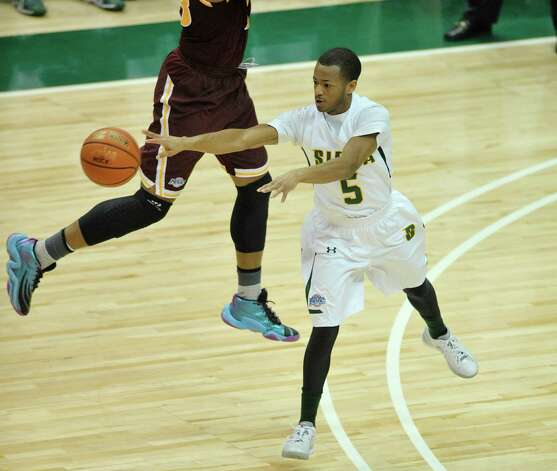 Evan Hymes of Siena passes to a  teammate during their game against Iona at the Times Union Center on Sunday, Jan. 4, 2014, in Albany, N.Y.  (Paul Buckowski / Times Union) Photo: Paul Buckowski / 00030029A