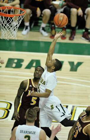 Evan Hymes of Siena drives to the basket during their game against Iona at the Times Union Center on Sunday, Jan. 4, 2014, in Albany, N.Y.   (Paul Buckowski / Times Union) Photo: Paul Buckowski / 00030029A