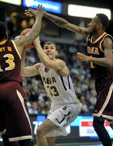 Rob Poole of Siena looks to put up a shot during their game against Iona at the Times Union Center on Sunday, Jan. 4, 2014, in Albany, N.Y.   (Paul Buckowski / Times Union) Photo: Paul Buckowski / 00030029A