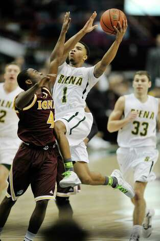 Marquis Wright of Siena, drives the lane and puts up a shot during their game against Iona at the Times Union Center on Sunday, Jan. 4, 2014, in Albany, N.Y.   (Paul Buckowski / Times Union) Photo: Paul Buckowski / 00030029A