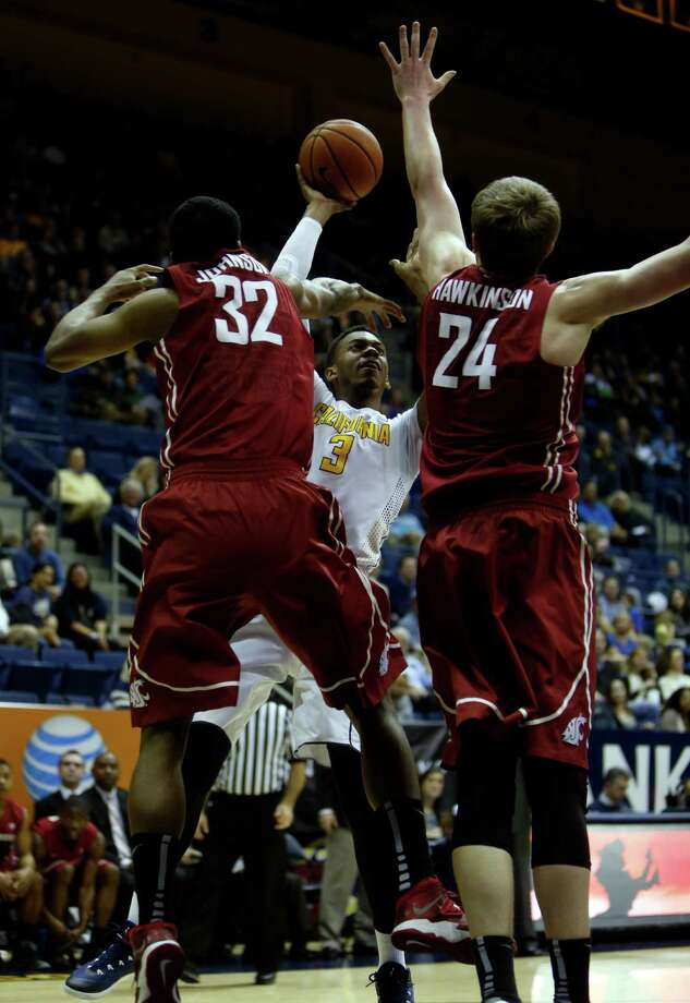Cal's Tyrone Wallace, who scored 16 points, looks for shooting room against Que Johnson (32) and Josh Hawkinson. Photo: Scott Strazzante / The Chronicle / ONLINE_YES