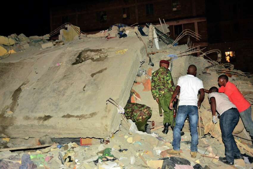 Kenya Para military soldiers and local Kenyans search for survivors of a multi-storey building collapse in the capital Nairobi, Kenya, Sunday, Jan. 4, 2015. The residential building in the Huruma neighborhood of Nairobi collapsed on Sunday and according to the Kenya Red Cross, over a dozen people have so far been rescued but an unknown number are still feared trapped.