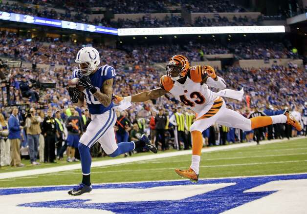 Indianapolis Colts wide receiver Donte Moncrief (10) makes a 36-yard touchdown reception against Cincinnati Bengals' George Iloka (43) during the second half of an NFL wildcard playoff football game Sunday, Jan. 4, 2015, in Indianapolis. (AP Photo/AJ Mast) ORG XMIT: NAS126 Photo: AJ Mast / FR123854 AP