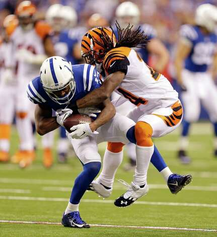 Indianapolis Colts' T.Y. Hilton, left, is tackled by Cincinnati Bengals' Adam Jones during the second half of an NFL wildcard playoff football game Sunday, Jan. 4, 2015, in Indianapolis. (AP Photo/Michael Conroy)  ORG XMIT: NAS132 Photo: Michael Conroy / AP