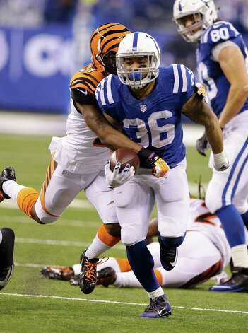 Indianapolis Colts running back Dan Herron (36) has the football stripped by Cincinnati Bengals cornerback Darqueze Dennard (21) during the first half of an NFL wildcard playoff football game Sunday, Jan. 4, 2015, in Indianapolis. The Bengals recovered the fumble. (AP Photo/Michael Conroy)  ORG XMIT: NAS124 Photo: Michael Conroy / AP
