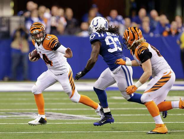 Cincinnati Bengals quarterback Andy Dalton (14) is chased by Indianapolis Colts outside linebacker Erik Walden (93) during the first half of an NFL wildcard playoff football game Sunday, Jan. 4, 2015, in Indianapolis. (AP Photo/Michael Conroy)  ORG XMIT: NAS121 Photo: Michael Conroy / AP