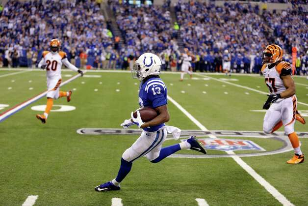 Indianapolis Colts wide receiver T.Y. Hilton (13) runs following a reception during the first half of an NFL wildcard playoff football game against the Cincinnati Bengals, Sunday, Jan. 4, 2015, in Indianapolis. (AP Photo/Michael Conroy)  ORG XMIT: NAS114 Photo: Michael Conroy / AP