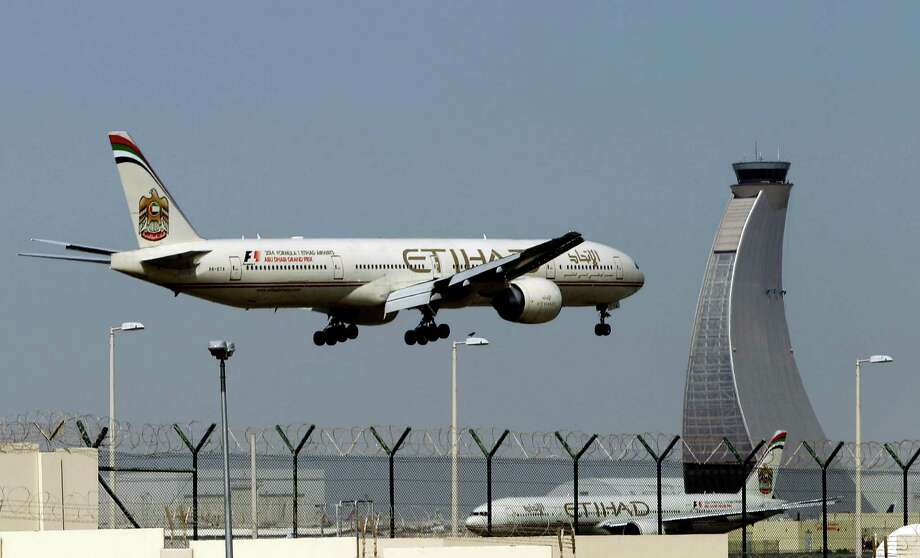 FILE - In this May 4, 2014 file photo, an Etihad Airways plane prepares to land at the Abu Dhabi airport in the United Arab Emirates. Hundreds of air travelers landed in San Francisco Saturday evening, Jan. 3, 2015, safe but irritated after a 28-hour Etihad overseas flight they say included 12 hours on a tarmac at the Abu Dhabi airport without food or accurate flight information. (AP Photo/Kamran Jebreili, File) Photo: Kamran Jebreili, STF / AP