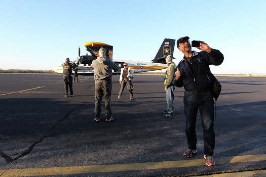 "Luis Soto, of San Juan, Puerto Rico, takes a photo with a U.S. Army Golden Knights Viking Twin Otter named ""George H.W. Bush"" at Stinson Airport, Sunday, Jan. 4, 2015. The Golden Knights provided tandem jumps to over a dozen people in the Center of Influence program. The program helps promote the Army's education and training opportunities and the members help make the connection with the public. Photo: JERRY LARA,  Staff / San Antonio Express-News / © 2015 San Antonio Express-News"