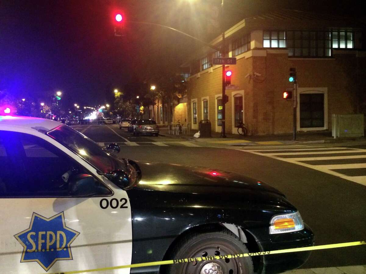 A police car is parked near the scene of an officer involved shooting at 17th Street and Valencia in front of the SFPD station in the Mission.