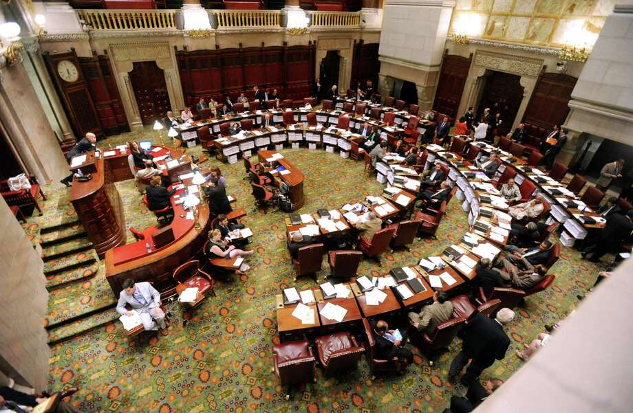 Members of the New York state Senate work in the Senate Chamber at the Capitol in Albany, N.Y., on Friday, June 21, 2013. Friday is expected to be the final day of the legislative session.  (AP Photo/Tim Roske) Photo: Tim Roske / FR61503 AP