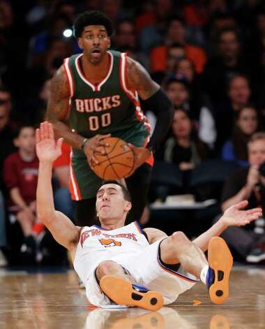Milwaukee Bucks guard O.J. Mayo (00) grabs the ball after New York Knicks guard Pablo Prigioni (9) lost it in the first half of an NBA basketball game at Madison Square Garden in New York, Sunday, Jan. 4, 2015. The Bucks defeated the Knicks 95-82, handing the Knicks their 11th straight loss. (AP Photo/Kathy Willens) ORG XMIT: MSG112 Photo: Kathy Willens / AP