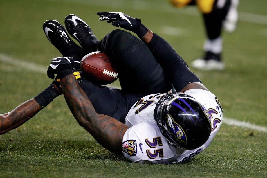 The Ravens weren't supposed to knock off the Steelers, but plays like Terrell Suggs' innovative between-the-legs interception made it a reality. Photo: Gregory Shamus, Stringer / 2015 Getty Images