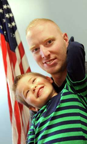 Thomas Kudlack of Watervliet with his son Caleb Kudlack 4, on Tuesday, Dec. 30, 2014, at the U.S. Dept. of Veterans Affairs in Albany, N.Y. (Cindy Schultz / Times Union) Photo: Cindy Schultz / 00030028A