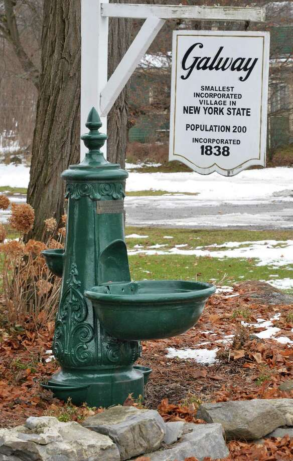 The historic 1907 village watering trough in Galway Village Park Thursday Dec. 18, 2014, in Galway, NY. A 15-year community effort concluded this month in Galway with the publication of a 300-page book that documents the changing history of the western Saratoga County town. (John Carl D'Annibale / Times Union) Photo: John Carl D'Annibale / 00029902A