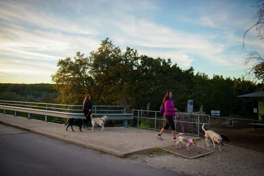 Leslie Persyn, right, and Phyllis Gutierrez, left, walk their dogs at Government Canyon State Natural Area in San Antonio, Tx. on Sunday, January 4, 2014. San Antonio City Council will soon vote on whether or not to annex additional lands in the property mid January. Photo: Matthew Busch, For The San Antonio Express-News / © Matthew Busch