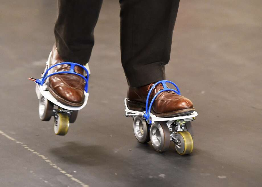 The Rollkers, a transportation accessory that increases a person's average walking rate up to 7 miles per hour, is seen in use on January 4, 2014 before the start of the 2015 Consumer Electronics Show in Las Vegas, Nevada.  2015 International CES, the world's largest showcase for the latest in consumer electronics, runs on January 6-9, with media preview days on January 4 and 5. Photo: ROBYN BECK, AFP/Getty Images