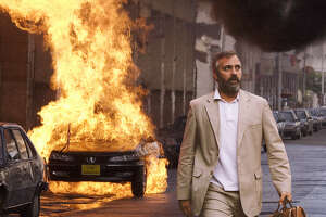 """**FILE**This undated file photo, originally supplied by Warner Bros., shows actor George Clooney in character in Warner Bros. Pictures' political thriller """"Syriana.""""  A French court dismissed a suit against  Clooney and Warner Bros. filed by a French screenwriter who alleged that the movie """"Syriana"""" was largely plagiarized from her script, court officials said Monday, June 19, 2006."""